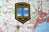 Kiev,Ukraine.JAN 10.Illustrative editorial.Ukrainian naval chevron.With map of Mariupil. City and port on Azov Sea.At present time frontline. At January 10,2015 in Kiev, Ukraine