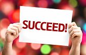 Succeed! card with colorful background with defocused lights