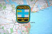 Illustrative editorial.Ukrainian naval chevron.With map of Odessa. City and port on Black Sea.At present time new navy base after Ukraine lost of Crimea. At January 10,2015 in Kiev, Ukraine