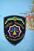 Kiev,Ukraine.JAN 10.Illustrative editorial.Chevron of Ukrainian Police in Sevastopol,Crimea. Former Ukraine.At present time Russia.With map of Sevastopol .At January 10,2015 in Kiev, Ukraine