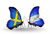 Two Butterflies With Flags On Wings As Symbol Of Relations Sweden And Nicaragua