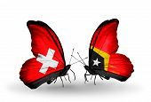 Two Butterflies With Flags On Wings As Symbol Of Relations Switzerland And East Timor
