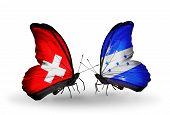 Two Butterflies With Flags On Wings As Symbol Of Relations Switzerland And Honduras