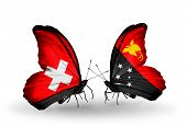 pic of papua new guinea  - Two butterflies with flags on wings as symbol of relations Switzerland and Papua New Guinea - JPG