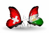 Two Butterflies With Flags On Wings As Symbol Of Relations Switzerland And Tajikistan