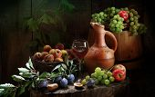 Wine, Peaches, Grapes, Apples, Plums And A Clay Jug