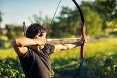 pic of archer  - Young archer training with the  bow - JPG