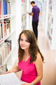Pretty young college student in a library (shallow DOF; color toned image)