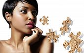 Closeup Portrait Of A Black Woman With An Ideal Skin And Puzzle With A Powder