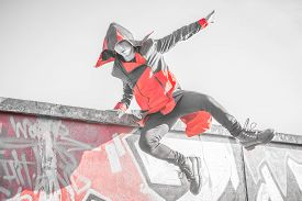 image of parkour  - man performing parkour jump with cosplay suite - JPG