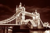 stock photo of london night  - Tower Bridge over Thames River at night in London - JPG