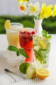 stock photo of refreshing  - Three glasses of refreshing drink Mohito - JPG