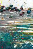 foto of discard  - Colorful contemporary artwork on the floor with multiple discarded empty paint cans conceptual of creativity inspiration and imagination - JPG