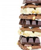 stock photo of white-milk  - Stack of white milk and dark chocolate isolated on white background - JPG