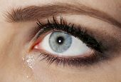 picture of tears  - Eye of young woman with tear drop close up - JPG