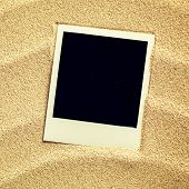 foto of beach shell art  - Summer like old style empty photo cards lying on a sea sand and framed with shells. Sunny summer background. Space for your text.  - JPG