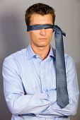 picture of blindfolded man  - Businessman blindfolded with tie - JPG