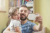 pic of selfie  - Young father with his cute little daughter taking selfie - JPG