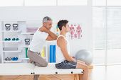 stock photo of herniated disc  - Doctor examining his patient back in medical office - JPG