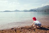 image of boys  - Cute boy playing and having fun on the beach - JPG