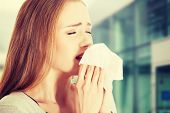 stock photo of sneezing  - Young beautiful caucasian woman sneezing - JPG