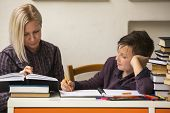foto of tutor  - Young student doing homework with a tutor - JPG