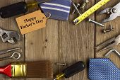pic of tied  - Happy Fathers Day gift tag with frame of tools and ties on a rustic wood background - JPG