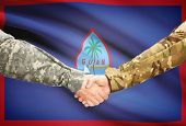 foto of guam  - Soldiers shaking hands with flag on background  - JPG
