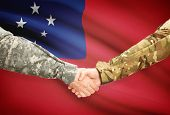 stock photo of samoa  - Soldiers shaking hands with flag on background  - JPG
