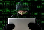 pic of computer hacker  - hacker man in black using computer laptop for criminal activity hacking password and private information cracking password too access bank account data in cyber crime concept - JPG
