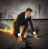 stock photo of sprinters  - Determined businessman leaving fire trails on asphalt - JPG