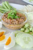 foto of thai cuisine  - Thai cuisine chili paste mixed with shrimp served with various vegetables and eggs - JPG