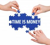 image of time-piece  - Hands with puzzle making TIME IS MONEY word isolated on white - JPG