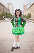 foto of cross-dress  - Young woman in irish dance dress and wig posing outdoor - JPG