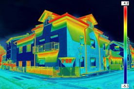 image of thermal  - Infrared thermovision image showing lack of thermal insulation on House - JPG