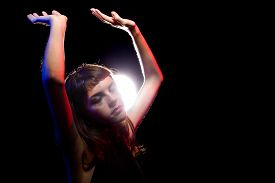 picture of debauchery  - intoxicated female dancing at a nightclub and high on drugs or drunk - JPG