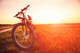 pic of biker  - Mountain biking down hill descending fast on bicycle - JPG