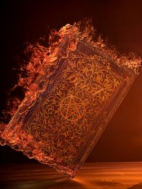 stock photo of occult  - Leather Book in flames With Pentagram - JPG