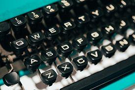 stock photo of qwerty  - Close Up Toned Photo Of Antique Typewriter Keys - JPG