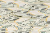 stock photo of ten thousand dollars  - Many Ten thousand dollar stacks to horizon - JPG