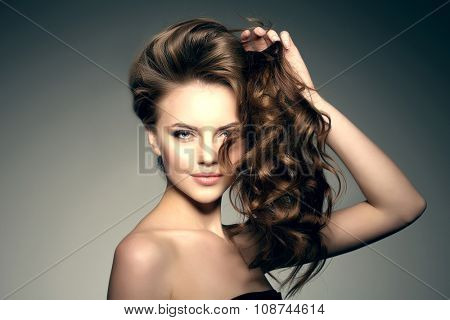 poster of Model with long hair. Waves Curls Hairstyle. Hair Salon. Updo. Fashion model with shiny hair. Woman