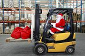 Santa Claus  forklift operator  in warehouse