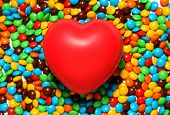 Soft Red Heart Over Candy Background poster
