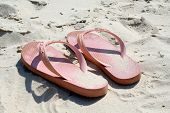 stock photo of bribie  - pink thongs on the beach with white sand - JPG