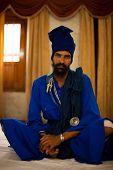 Sikh Man Blue Sitting