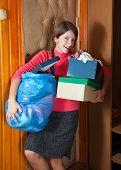Woman Taking Away The Garbage