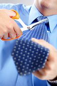 Businessman Cutting The Tie