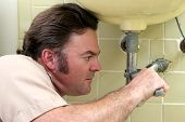 Plumber Tightening Pipe