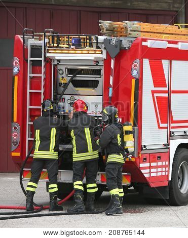 Firefighters And Tanker Trucks