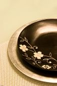 Beautiful Black Plate With Flower Carving On A Dinning Table